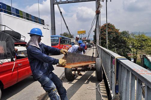 Imágenes: avanzan obras de reparación del puente de Juanchito